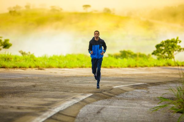 Man running outside to get exercise
