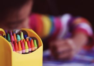 Young child with asthma coloring at school