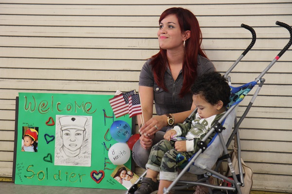 mother and son wait for military family member