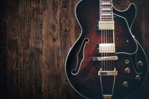 Wooden instrument guitar on wood floor