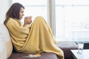 Sick woman during winter from dry air