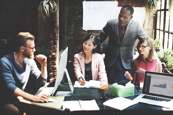 Team meeting excelling and contributing to company's bottom line
