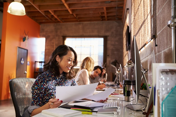Woman productively works in asthma-friendly workplace