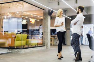 Employees discussing corporate wellness program