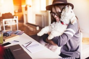 Woman and her dog read Venta blog articles for Asthma and Allergies Awareness Month