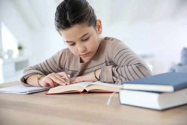 Child having difficulty studying in school with poor indoor air quality